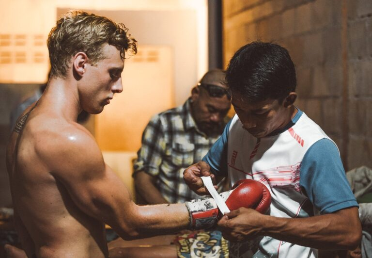 boxer wrapping hands before fighting muay thai in thailand