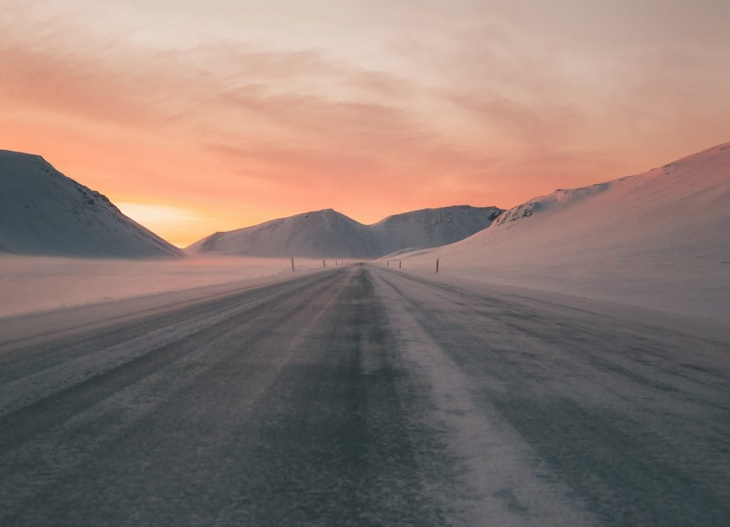 Iceland on a budget road at sunset