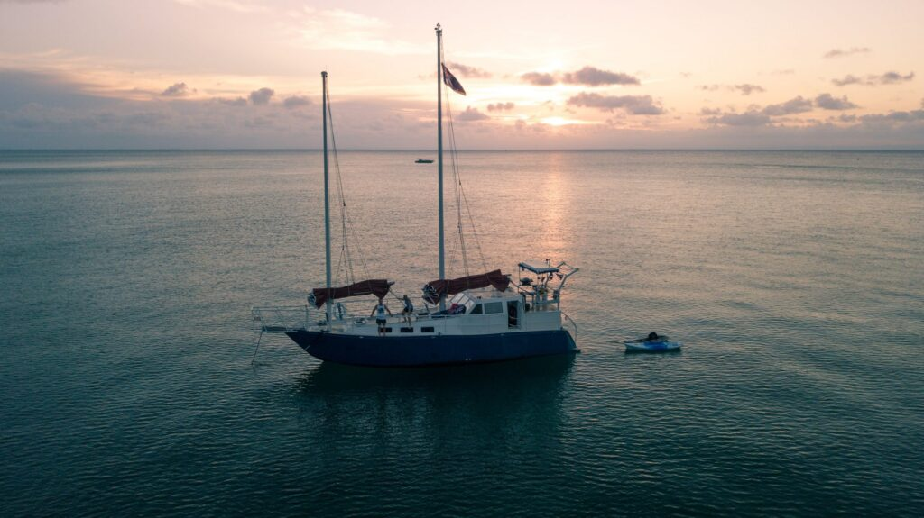 sunset drone shot of sailing boat malaika