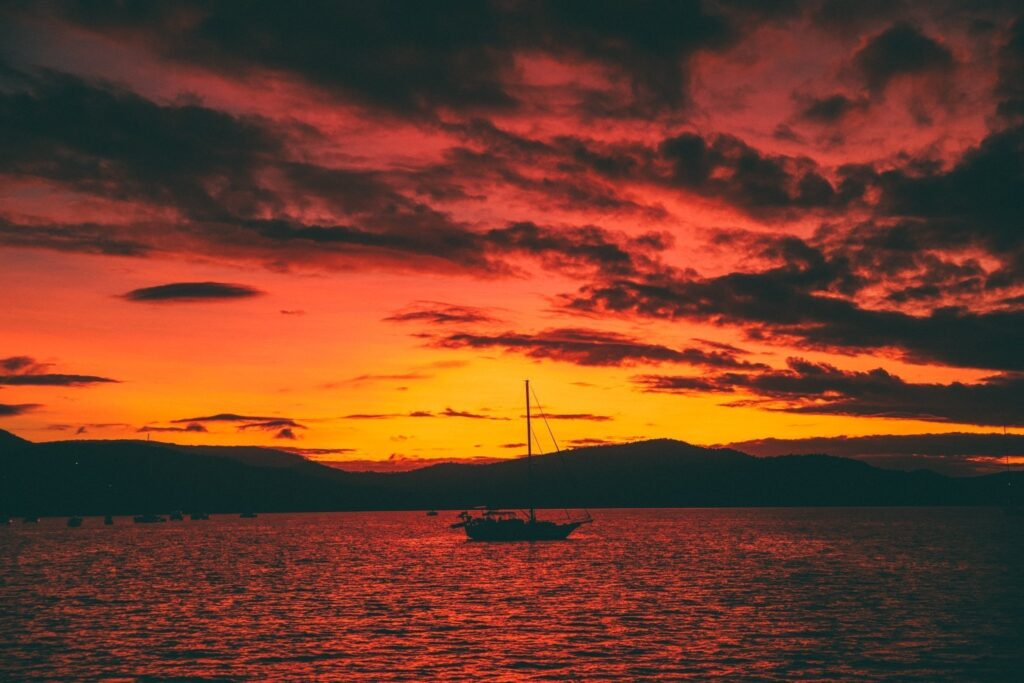 sunsets on the water at airlie beach
