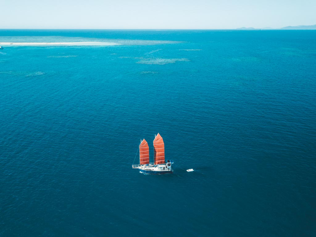 SAILING YACHT AT THE GREAT BARRIER REEF