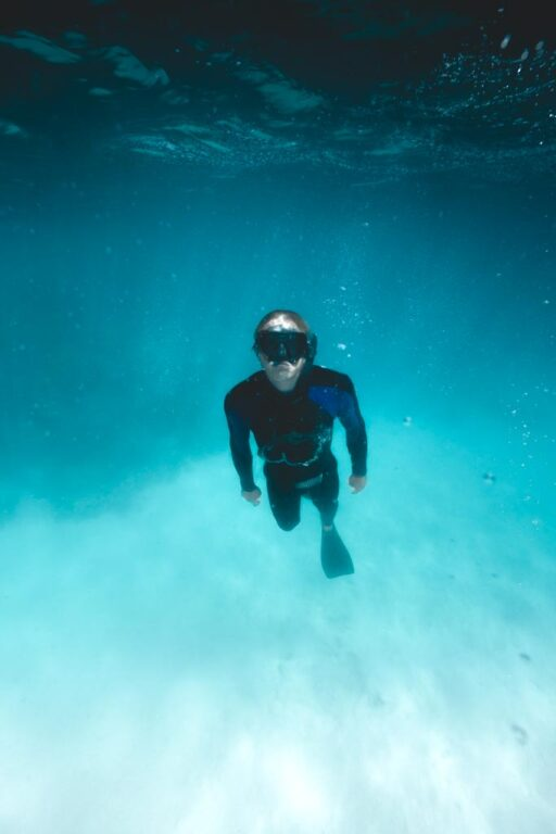 SNORKELING AT THE GREAT BARRIER REEF NEAR CAIRNS WITH STINGER SUIT