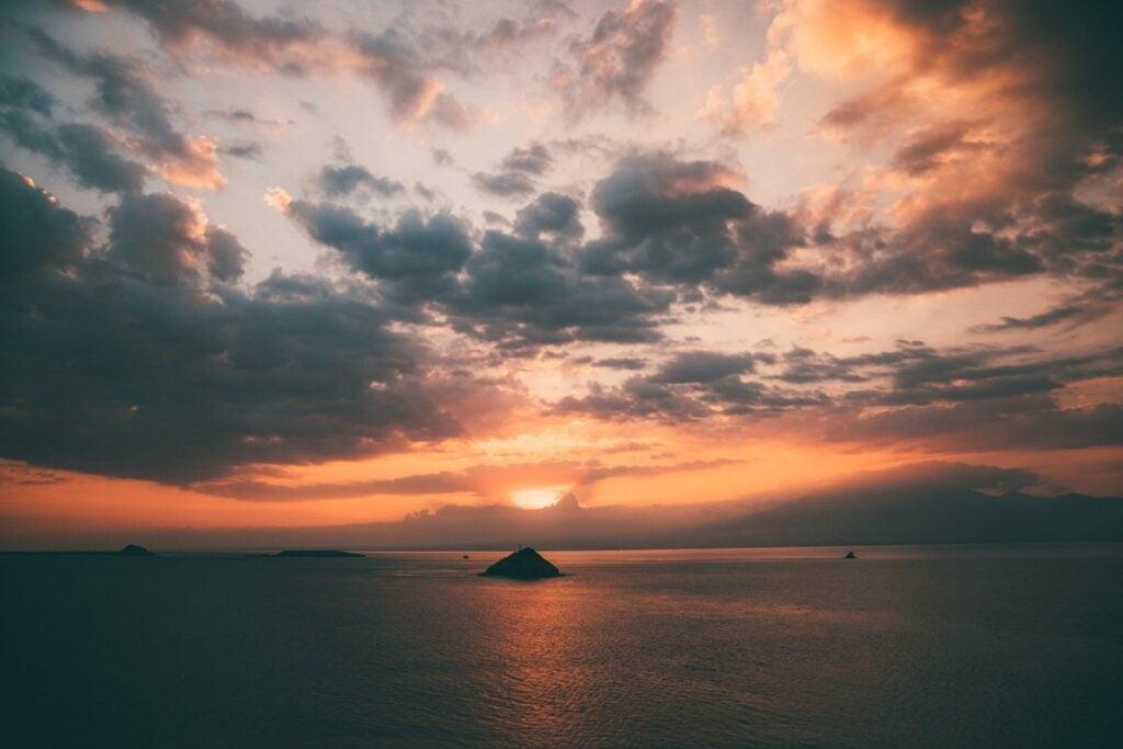 SUNSET AT KENAWA ISLAND NEAR LOMBOK INDONESIA