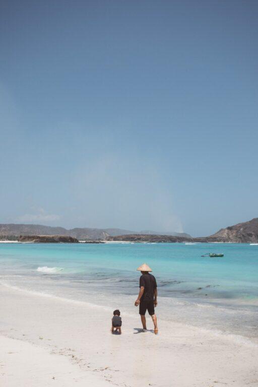 MAN AND SON ON TANJUNG AAN BEACH, PANTAI, BEACHES NEAR KUTA LOMBOK