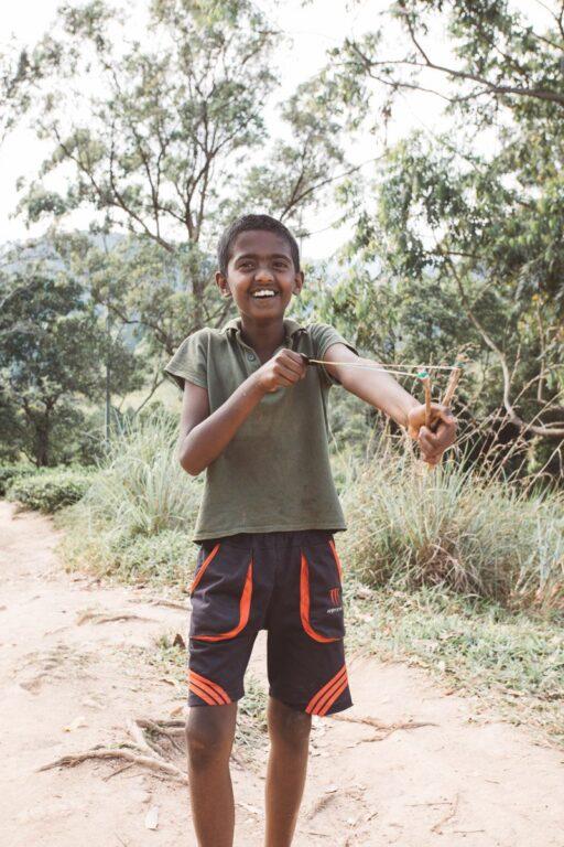PORTRAIT OF A BOY WITH A SLINGSHOT IN ELLA, SRI LANKA