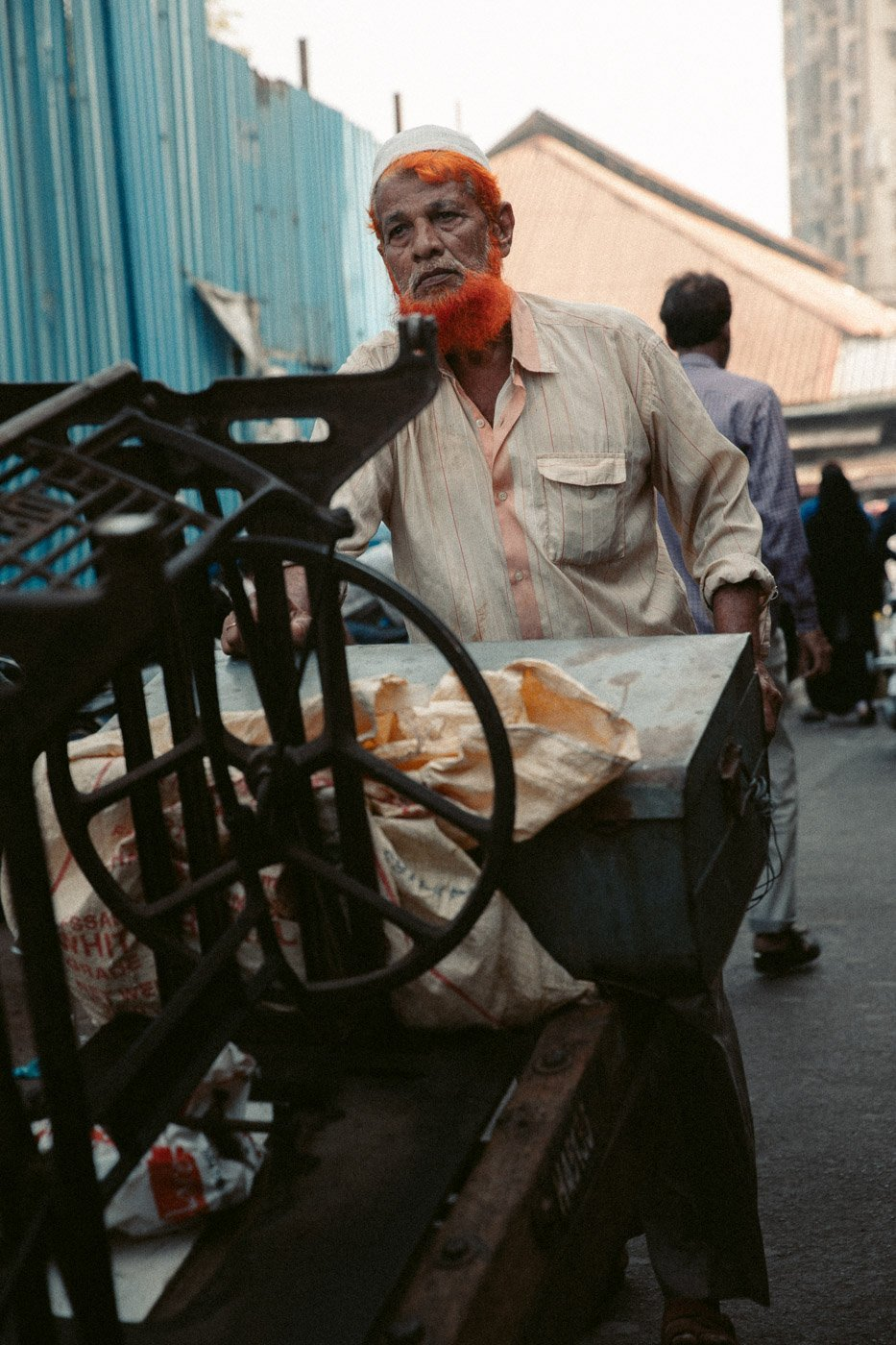 PORTRAIT OF A MAN IN MUMBAI'S THIEVES MARKET
