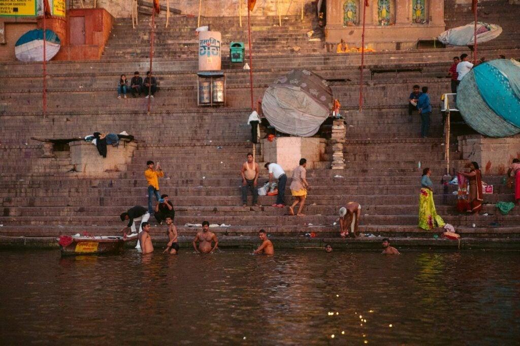 BATHING IN THE GANGES RIVER VARANASI